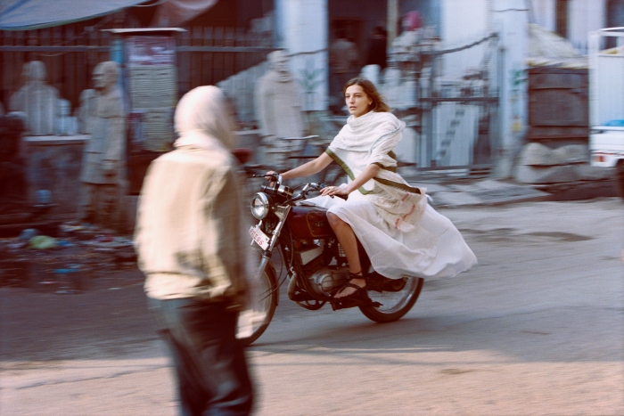 Daria on Motorcycle in Varanasi, 2012  Archival pigment print  30 x 40 inches  Edition number 1 of 10